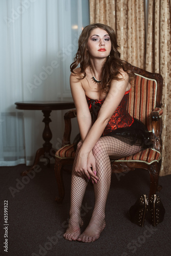 Beautiful sexy woman sitting on chair