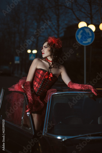 Young sexy woman near car