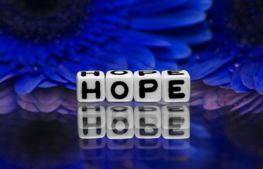 Hope text with blue flowers