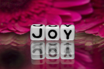 Joy text with flowers