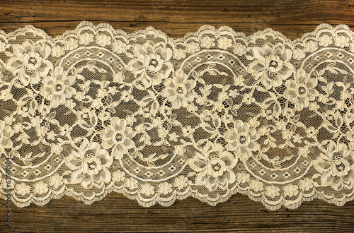 Old boards covered with beautiful lace © smiltena