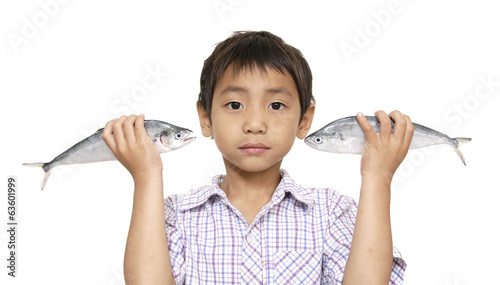 little kid holding fresh fish