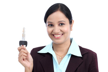 Happy young business woman holding key