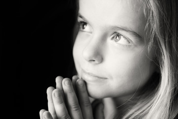 Close Up of Little Girl Praying. Monochrome.