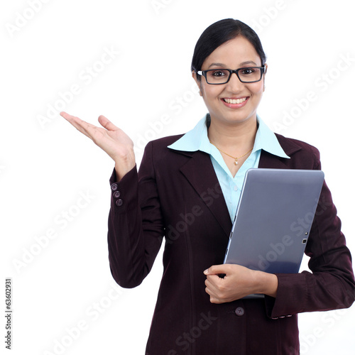 Young smiling business woman holding tablet computer