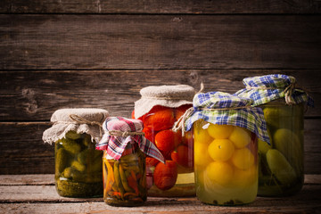 Vegetable preserves on wooden background