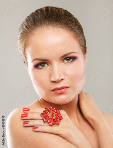 Young and beautiful woman with red ring.