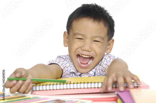 Closeup portrait of a smiling little boy doing homework