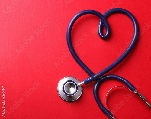 Stethoscope isolated on red background.