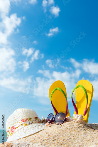 Summer beach vacation with flip flop, sunglasses and floppy hat