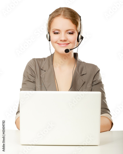 business woman working at her desk with headset and laptop.