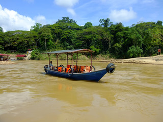Tourist boat on Tembeling river, Taman Negara National Park, Mal