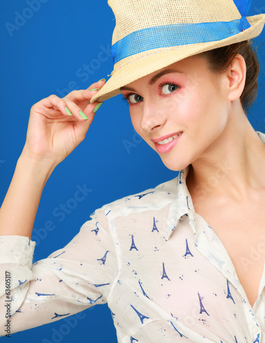 Portrait of beautiful model in hat ,isolated on blue background.