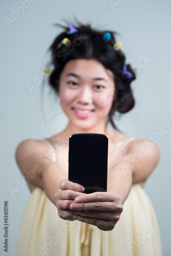 Asian girl with mobile.