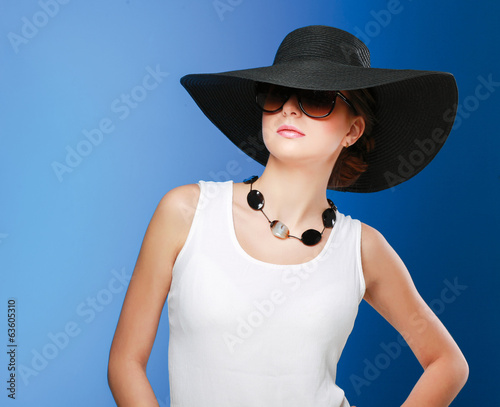Portrait of beautiful model in hat with glasses