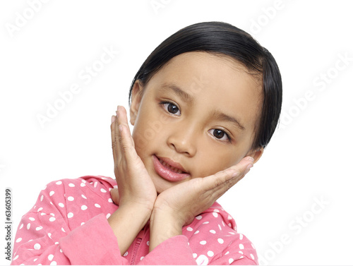 Little girl expressing surprise over white background