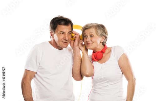 Senior couple with headphones