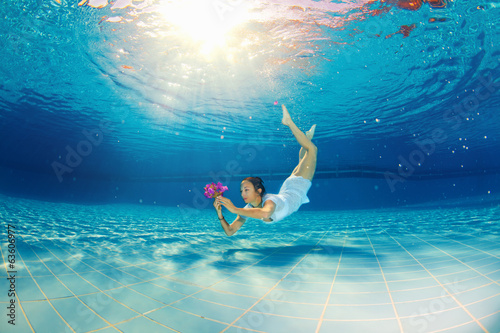 girl diving in the pool