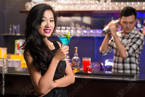 Asian woman with a drink