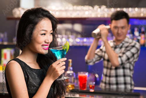 Vietnamese woman with a drink