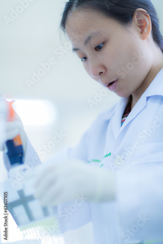 Scientist using a pipette