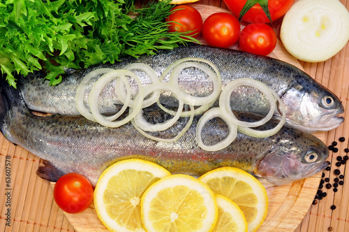 two rainbow trout with lemon and fresh vegetables