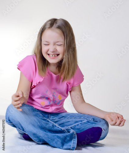 the girl sits on a floor