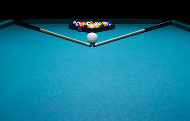 Billiard balls the center of table.