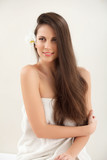 Brown Hair. Beautiful Brunette with Long Hair. Haircare.  poster
