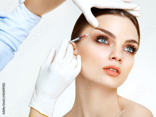 canvas print picture Beautiful woman gets injections. Cosmetology. Beauty Face