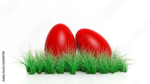 Two red painted Easter eggs with green grass isolated