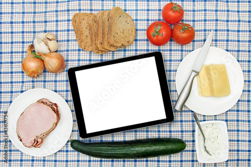 breakfast table with blank digital tablet in the center