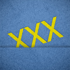 xxx icon on blue paper texture