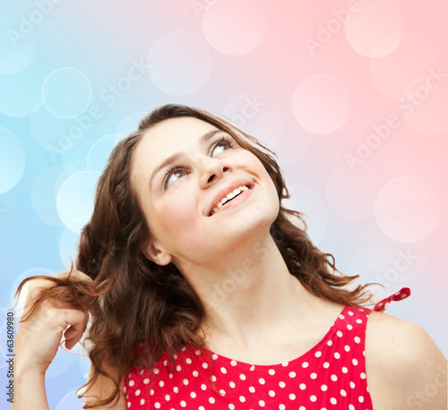 Surprised beautiful young woman  on  multicolored background