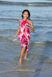 girl running from sea