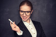 business woman teacher with glasses and a suit with chalk   at a