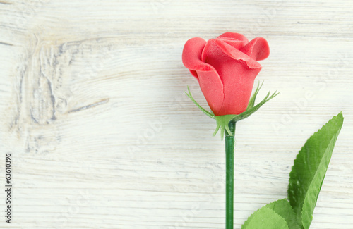 marzipan rose on wooden surface
