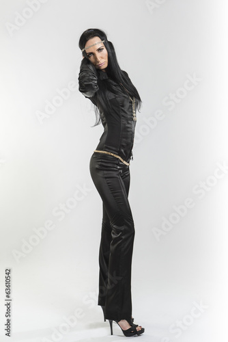 Pretty Caucasian woman in black leather catsuit
