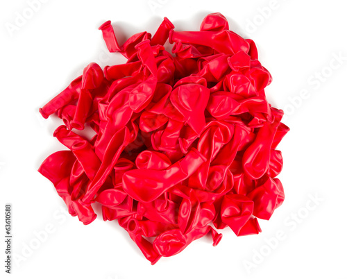 deflated red air ballons isolated on white