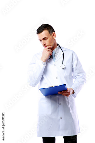 Pensive male doctor with clipboard and stethoscope
