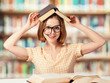 tired funny girl student with glasses reading books