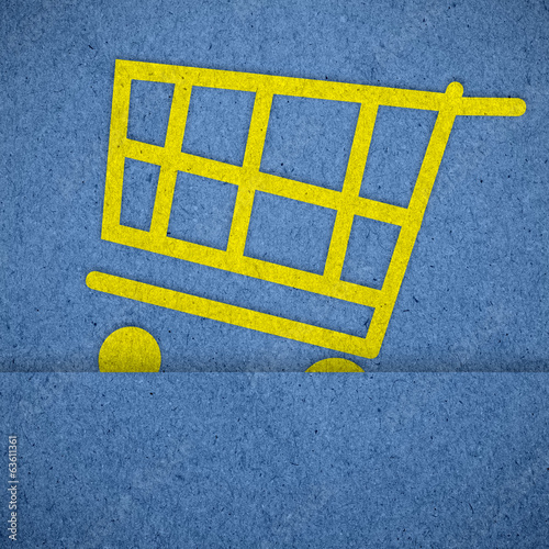 shopping cart icons on blue paper texture