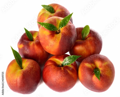 Seven ripe nectarines isolated on white background