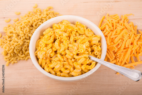 Dry Macaroni and Grated Cheese with Bowl of Mac n Cheese