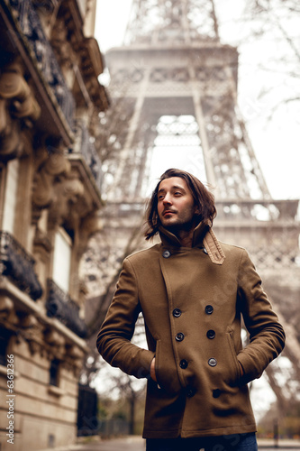 Man posing on Eiffel tower background
