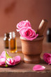 spa set with rose flowers mortar and essential oil