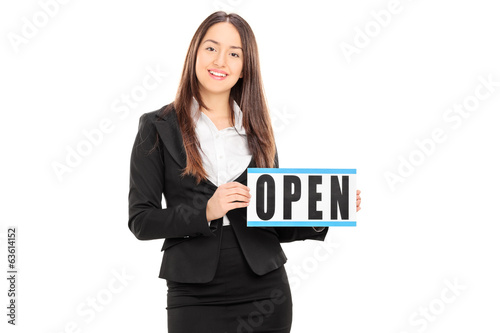 Female retailer holding an open sign