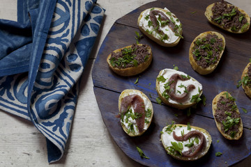 canapes with anchovies and olive paste with fresh parsley