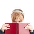 Closeup portrait of blond Caucasian schoolgirl with red book