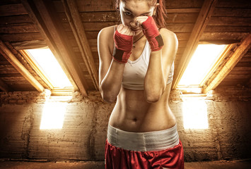 Young women boxing, exercise in the attic